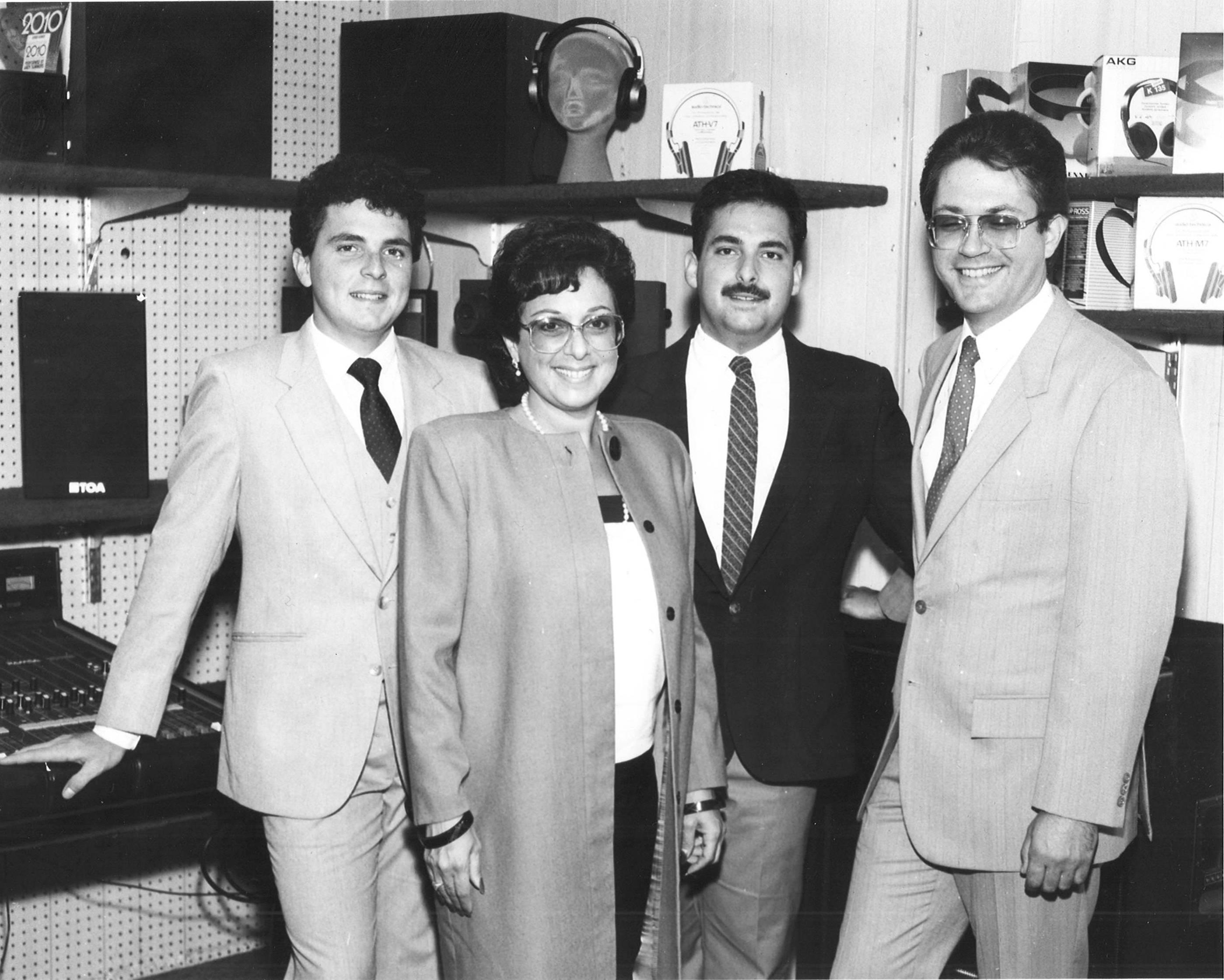 Susan and Jonathan with their sons Steven Cohan (left) and Jeff Lipp, in the Full Compass office, 1981