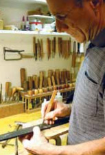 Robert Benedetto inlays the fingerboard of his 45th Anniversary guitar.