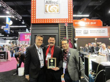 Alfred's Antonio Ferranti and Ron Manus with Long & McQuade's Bob Kohl (center).