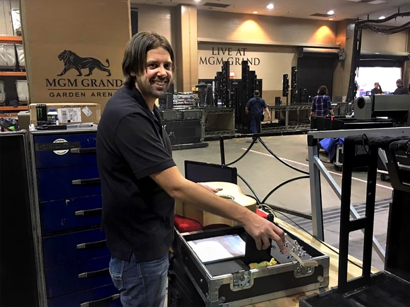 Mike Miltimore (Riversong Guitar founder) at tech station.